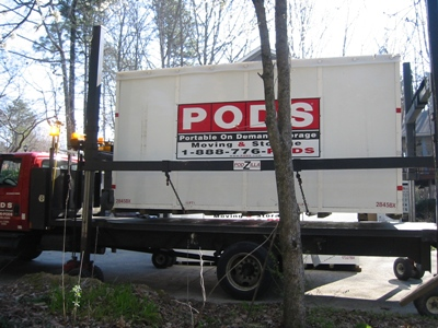 The first POD being picked up by its truck for delivery to a storage location